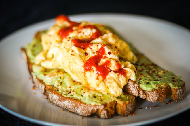 Spicy Avocado with scrambled eggs, served on two slices of toast